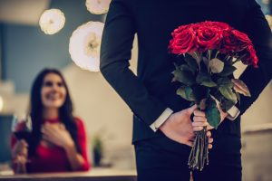 Man about to surprise woman with roses valentines day