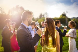 man and woman guest at a summer wedding